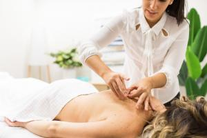 Livia performing Acupuncture on a client