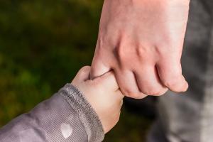 Holistic Acupuncture infant holding parents finger
