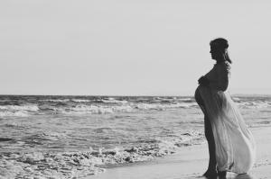 Holistic Acupuncture pregnant woman on beach