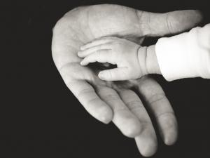 Holistic Acupuncture baby hand in adults hand